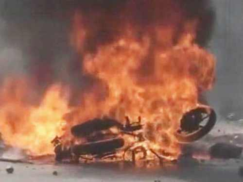 Unidentified persons set a bike to fire