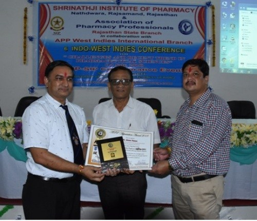 Shrinathji Institute Professors felicitated at Indo-West Indies Pharmacy conference