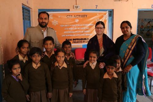 Sweaters and kits distributed by Ravi Infrabuild