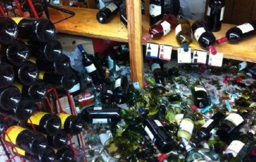 Police accused of damage in liquor shop