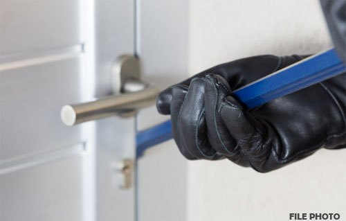 Man locked in room-Thieves make way with mobiles