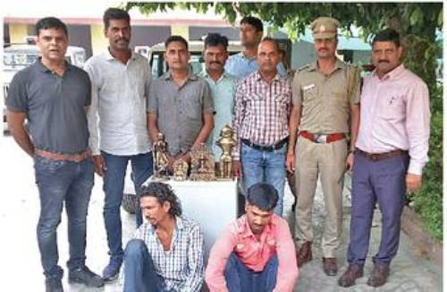 2 arrested with precious antique statues