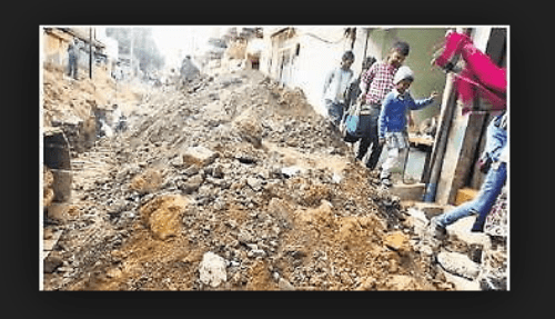 Road left unrepaired after sewerage line work